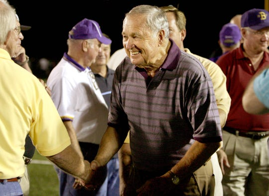 September 8, 2006 - Former CBHS coach Tom Nix greets members of his former football team after Nix received an award from the high school during halftime. (Nikki Boertman/The Commercial Appeal)