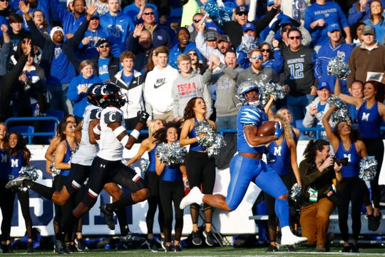 Dec. 7, 2019 - Memphis wide receiver Antonio Gibson sprints the sidelines for a touchdown against Cincinnati during the AAC Championship at Liberty Bowl Memorial Stadium.