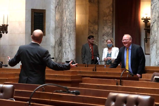 Assembly Majority Leader Jim Steineke, R-Kaukauna, left, invites other members to socially distance themselves as they arrive in the Assembly chambers on Tuesday.
