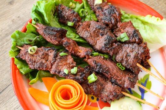 Part of the menu at Sweet Basil in Franklin is dedicated to street food, like these beef teriyaki skewers.