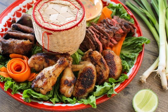 Sweet Basil's family platters includes a Lao barbecue platter: chicken wings, grilled steak, Asian ribs with sticky rice and choice of Jeow dipping sauce.