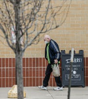 A shopper wears a mask as he exits the Brookfield Pick 'n Save on Friday, April 10, 2020. Pick 'n Save and Metro Market grocery stores have implemented exclusive shopping hours for seniors 60 and older between 6 a.m. to 8 a.m. daily.