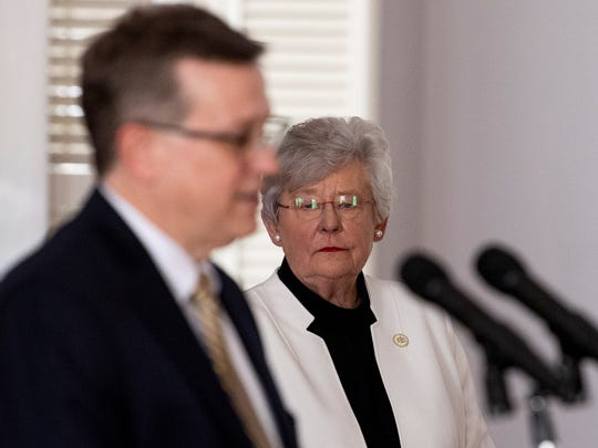 Governor Kay Ivey looks on as State Health Officer Dr. Scott Harris speaks at a coronavirus update briefing in the state capitol building in Montgomery, Ala., on Tuesday April 14, 2020.
