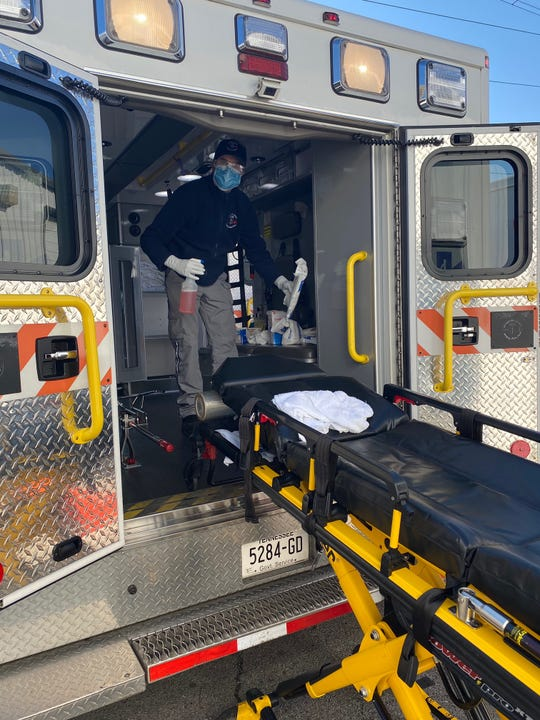 Rutherford County Emergency Medical Service employee cleans ambulance.