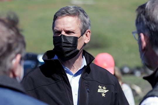 Tennessee Gov. Bill Lee, center, visits a storm-damaged area Tuesday, April 14, 2020, in Chattanooga, Tenn. Tornadoes went through the area Sunday, April 12.