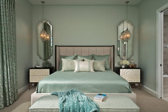 The master bedroom is an elegant retreat with custom bedding in sea mist and silver sage tones.