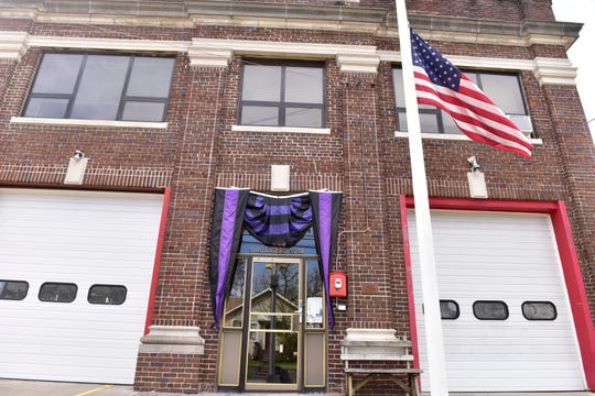 Bunting hangs over the door at the Singac Fire House to honor the passing of Michael Burke, President of Little Falls Fire Department, who died from complications to the coronavirus.