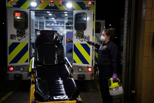 Hackensack Volunteer Ambulance Corps member Johanna Stange decontaminates ambulance equipment after a call on Tuesday, April 7. 2020.