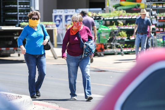Shoppers wear masks and gloves while at Lowe's in Las Cruces on Saturday, April 4, 2020.