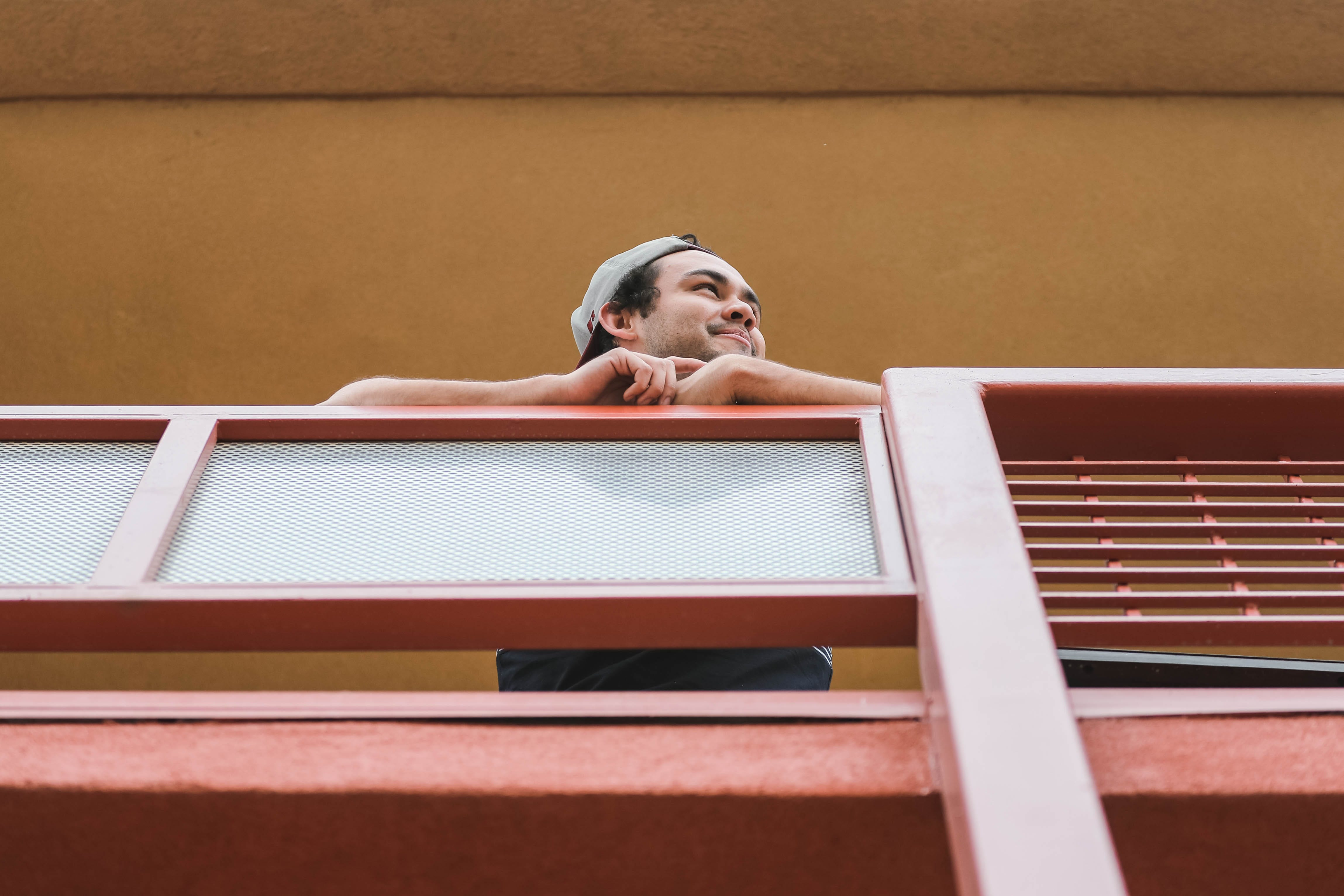 New Mexico State international student Daniel Barrio stands out on his apartment balcony on Thursday, March 26, 2020, during what would have been class hours before school was canceled due to Coronavirus concerns in Las Cruces.