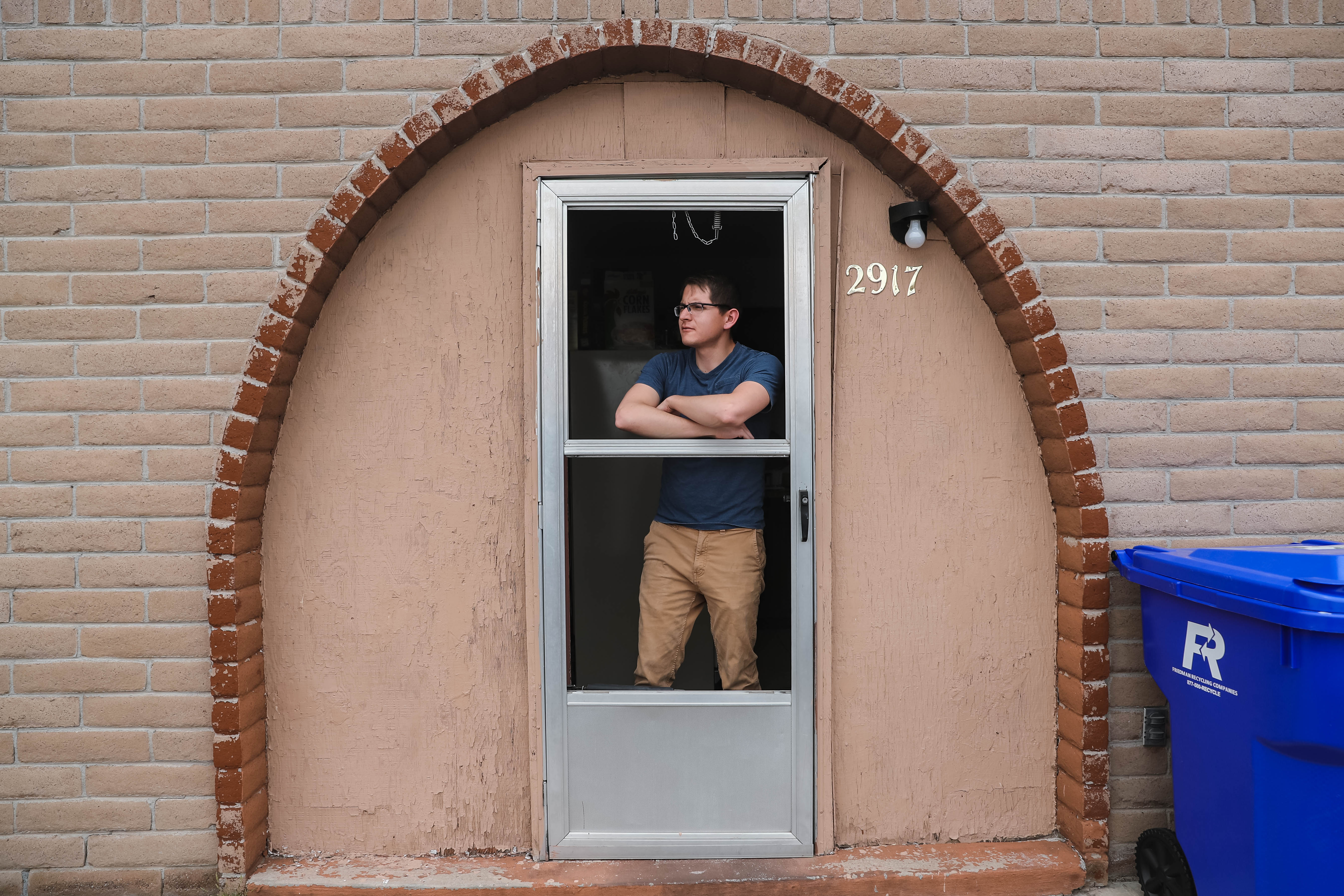 New Mexico State aerospace engineering major Martin Andazola looks out from his porch on Friday, April 3, 2020, during what would have been class hours before school was canceled due to Coronavirus concerns in Las Cruces.