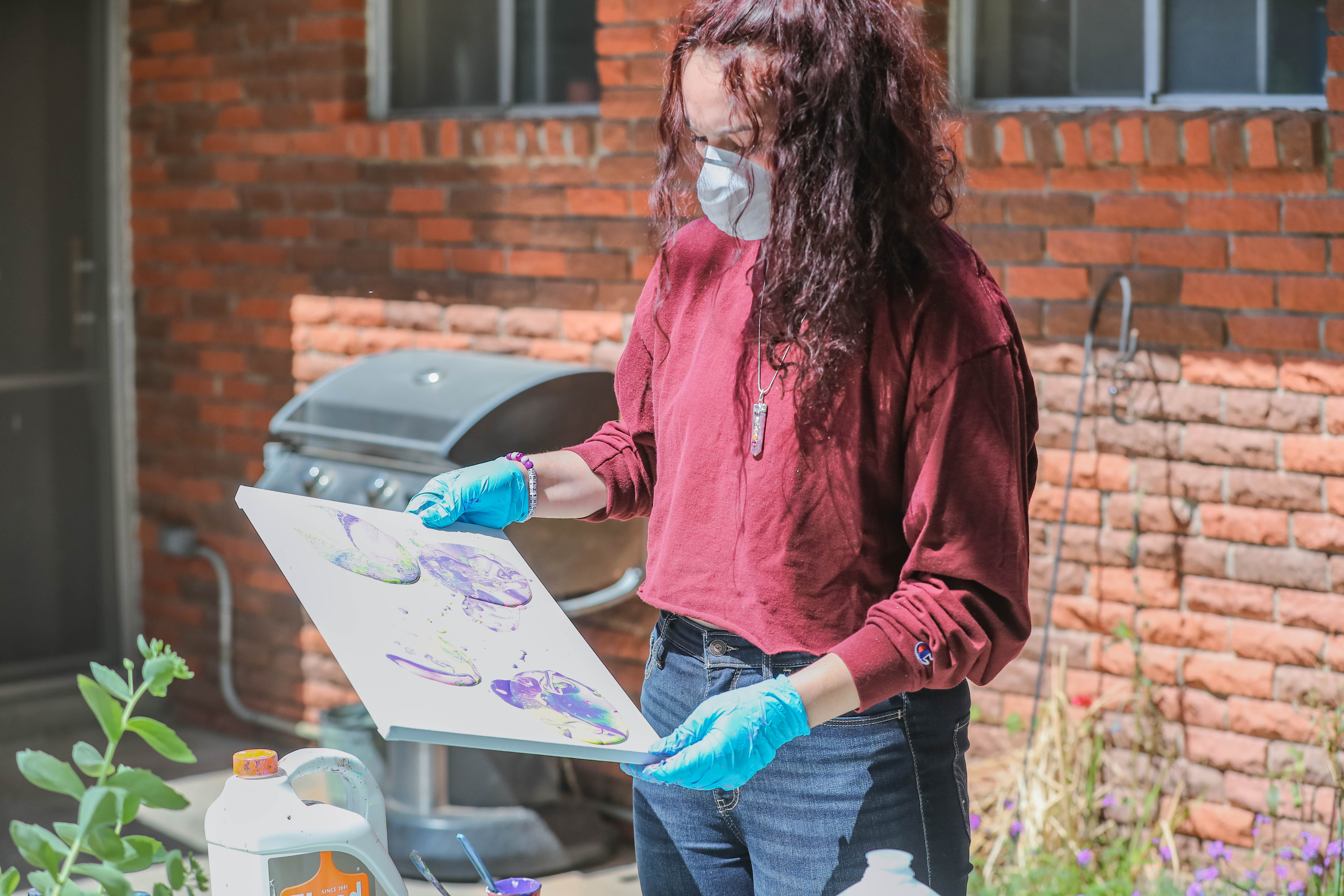 Merrell Gomez paints in her backyard while in quarantine in Las Cruces on Thursday, April 9, 2020. Gomez would have been working at Bath and Bodyworks.