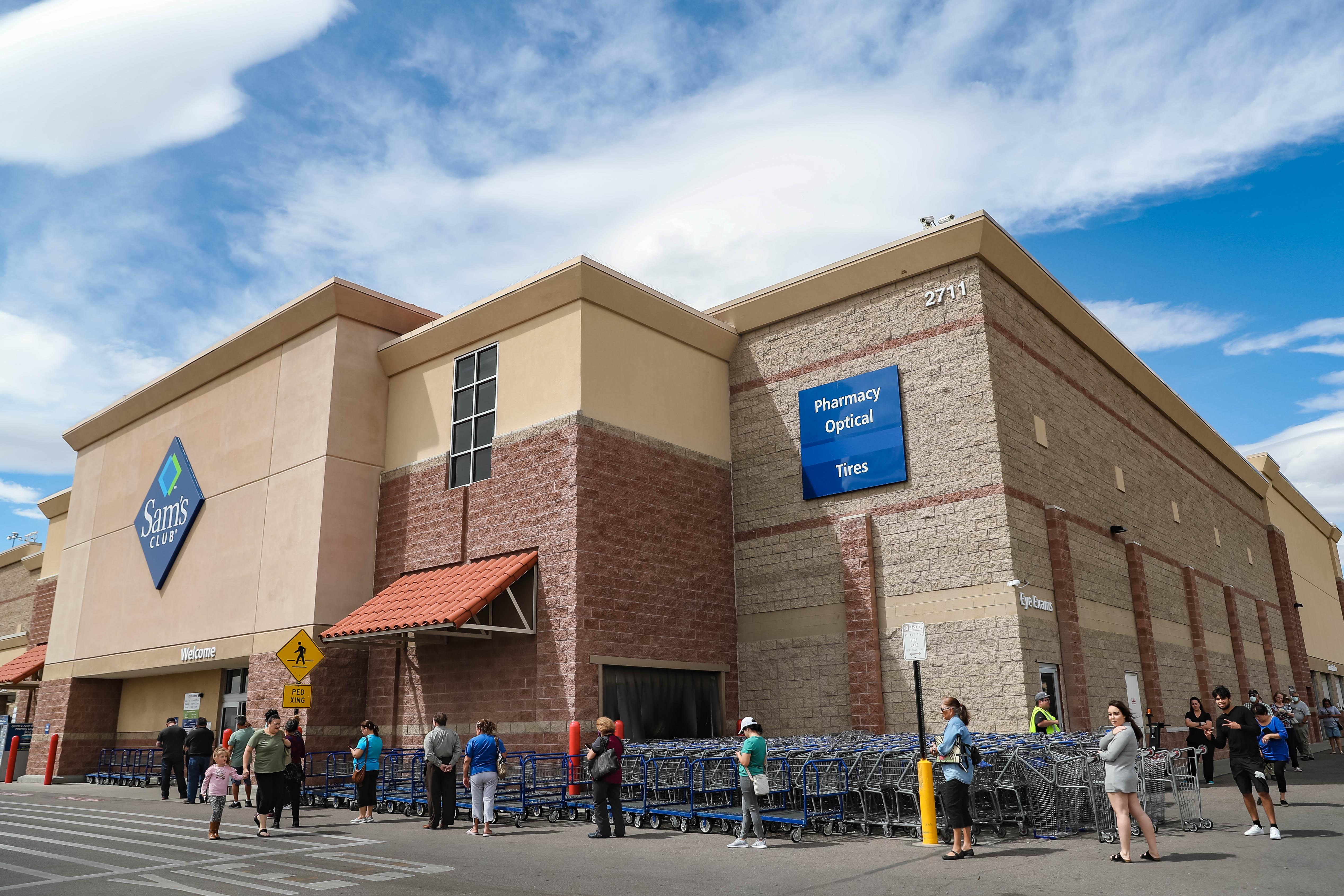 Dozens wait in a line, spread six feet apart, to shop at Sam's Club in Las Cruces on Wednesday, April 1, 2020.