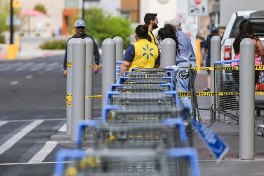 Walmart uses shopping carts and yellow caution tape to direct pedestrian traffic flow in and out of the store in Las Cruces on Wednesday, April 1, 2020.