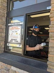 At Alamogordo business Fatwood Barbeque, staff have had to learn how to adapt to coronavirus restrictions on essential businesses in New Mexico, such as by offering drive thru food services. Courtesy photo.