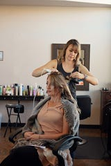 Owner Maggie Nowell styles a client's hair at Blush Beauty Bar in Alamogordo before the business closed temporarily due to the coronavirus. Courtesy photo.