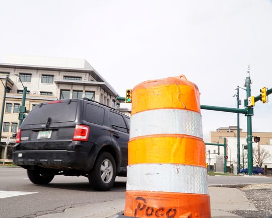 An orange barrel lies at the corner of Maple and Woodward in Birmingham - anticipating construction work on Maple that will occur this summer.