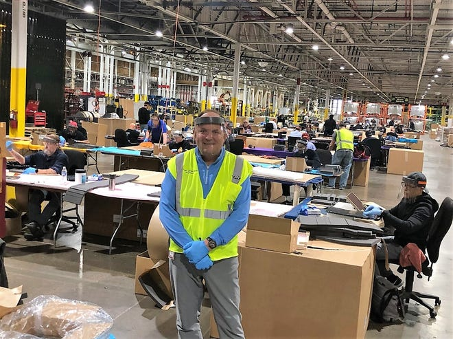 Todd Jaranowski, president of Ford subsidiary Troy Design and Manufacturing, oversees the production of face shields at TDM's Plymouth Township plant.