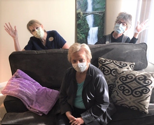 """These three are behind Brookdale Novi's popular video, """"Ode to Covid-19.""""  Writer and performer Julie Cox, 78, sits between background performer Carolyn Storey, the facility's resident programs assistant on her left, and Carolyn Kokko, the resident programs coordinator who recorded their performance."""
