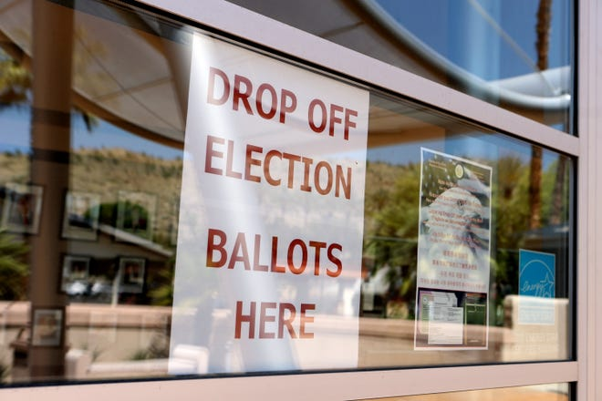 A sign alerting voters to drop off election ballots is posted in the window at Ranch Mirage City Hall in Rancho Mirage, Calif., on Tuesday, April 14, 2020.