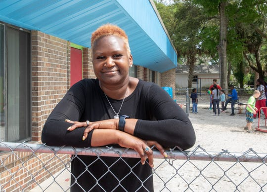Shanna Robinson, owner of House of Prayer Learning Center on Barrancas Avenue in Pensacola, stands in the center's playground Tuesday. The center is serving children of health care workers and first responders who must work during the coronavirus pandemic.