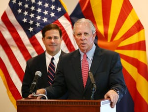 Dr. Robert C. Robbins, president of the University of Arizona, and Gov. Doug Ducey (left) give an update on the COVID-19 pandemic response during a press conference at the Arizona Commerce Authority in Phoenix on April 14, 2020.