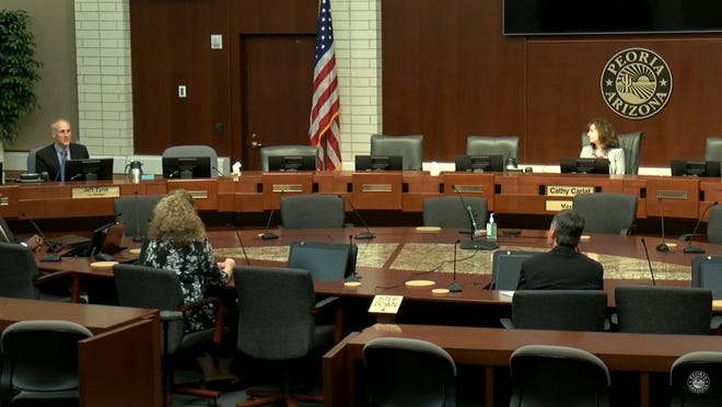 Metro Phoenix cities are holding meetings online because of the COVID-19 pandemic. In Peoria, the mayor and a handful of city staff physically attend, while City Council members call in.
