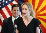 Arizona Gov. Doug Ducey and Arizona Department of Health Services Director Dr. Cara Christ (left) give an update on the COVID-19 pandemic response during a press conference at the Arizona Commerce Authority in Phoenix on April 14, 2020.