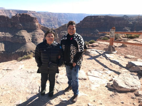 Sen. Jamescita Peshlakai (right) with her mother Mae. Peshlakai's home on the Navajo Nation lacks running water and electricity, as do about 7,500 other homes in the nation.