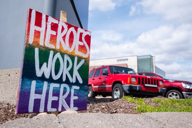 A sign celebrating the medical staff at McLaren Port Huron is posted outside the hospital Tuesday, April 14, 2020, at the corner of Pine Grove Avenue and Erie Street.