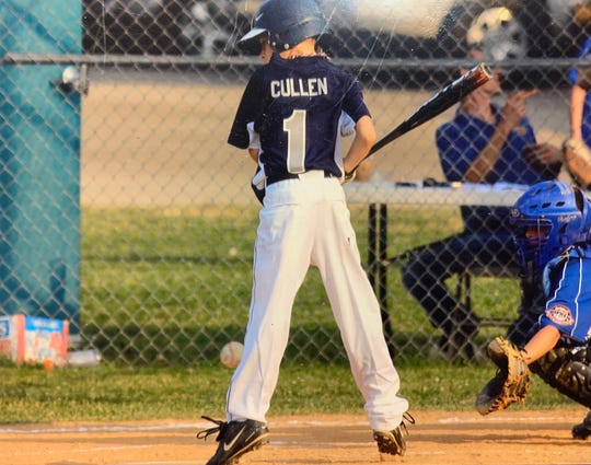 Patrick Cullen, then 10 years old and playing youth baseball, jumps back as a pitch sails toward his leg.