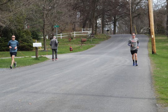 David Osterhoudt (right) is running on Old Post Road in Staatsburg with Ed King (left) to celebrate his 43rd birthday