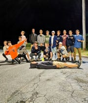 Members of the John Jay boys track and field team pose together in the parking lot of the I-84 Diner in Fishkill after a meet.