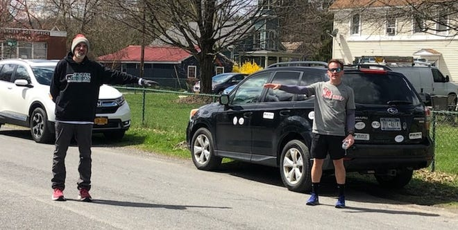 David Osterhoudt (right) and Peter Colaizzo (left) are practicing social distancing on Old Post Road in Staatsburg post running.
