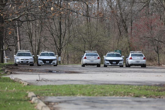Many Rochester police file their reports from their vehicles instead of going into the office.  These five cars were in a lot near the Genesee Valley Park Sports Complex on Tuesday, April 14, 2020.
