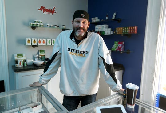 Andrew Ribble of Liquid Cloud Lounge on Monroe Avenue is one of the local vape shops that has been able to remain open during the coronavirus quarantine.
