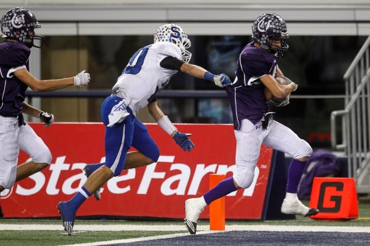 Mason High School's Chance Stockbridge runs into the end zone after intercepting a Stamford pass in the Class 1A Division I state final Dec. 15, 2011.