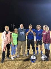 The family of Richland Springs junior Matthew Rigdon (4) pose for a photo after a game during the Coyotes' 2019 state championship season.