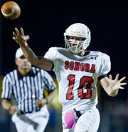 Sonora quarterback Ethan Morriss fires a touchdown pass to receiver Word Hudson during a 2010 game against Ozona.