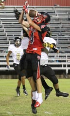 Ballinger's Kasey Byler is unable to haul in a pass as time expires in the first half of a 2013 game against Brady.