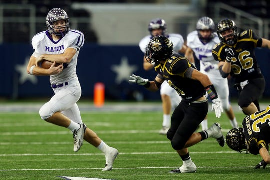 Mason High School's Seth Hudson moves the ball up the field during the Class 2A Division I state final against Canadian on Dec. 18, 2014.