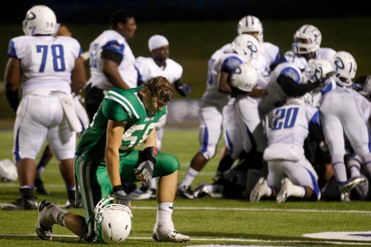 Wall High School's Jacob Reid takes a knee as the Daingerfield Tigers celebrate a 29-22 win in their Class 2A Division I state semifinal playoff game in Waco. Wall finished its season 12-2.