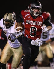 Sonora Broncos running back Chance Campbell runs against Post in their second-round playoff game in 2013.
