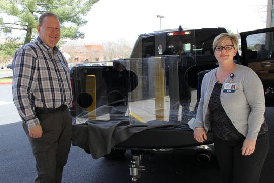 Kevin Justice, executive director of M4Reactor, delivers a shipment of laser-cut intubation boxes and face shields to Sarah Arnett, chief nursing officer at Peninsula Regional Medical Center in Salisbury April 3.