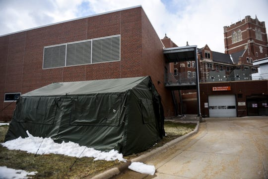 Royal C. Johnson Veterans Memorial Hospital prepares for the potential for more coronavirus cases on Tuesday, April 14, 2020 in Sioux Falls, S.D. A tent set up behind the hospital will allow for additional space.