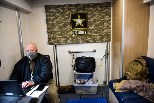 Veteran Outreach Program Specialist Ken Colson works from a Vet Center mobile unit on Tuesday, April 14, 2020 in Sioux Falls, S.D. The Vet Center mobile unit will allow patients to have blood work done without entering the hospital.