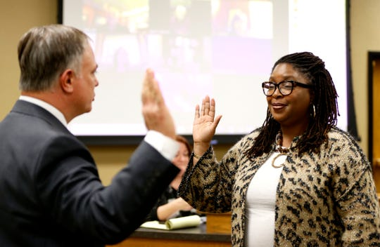 New Springfield Public Schools board member Shurita Thomas-Tate is sworn in by Greene County Clerk Shane Schoeller at a board meeting on Tuesday.