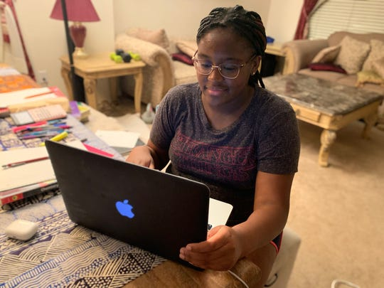 Gracie Mainoo, a Stuart Hall student, studies remotely in her home in Grand Prairie, Texas.