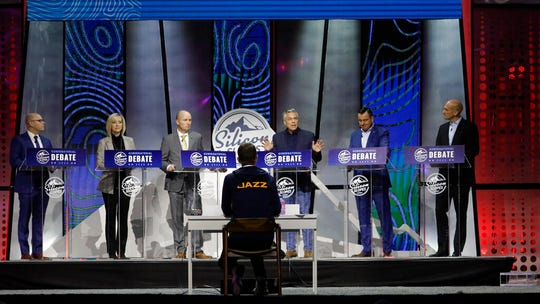 From left to right, Jeff Burningham, Aimee Winder Newton, Spencer Cox, Jon Huntsman Jr., Greg Hughes and Thomas Wright stand on the stage during a debate for Utah's 2020 gubernatorial race Friday, Jan. 31, 2020, in Salt Lake City. Six candidates vying for the GOP nomination in the Utah governor's race meet for their first debate. The debate is part of the Silicon Slopes Tech Summit, a conference for the state's burgeoning tech sector. (AP Photo/Rick Bowmer)