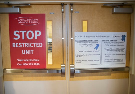 A large sign identifying this wing is dedicated as a coronavirus wing is posted in Capital Regional Medical Center, Tuesday, April 14, 2020.